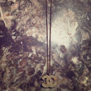 Authentic Chanel gold pearl logo charm necklace